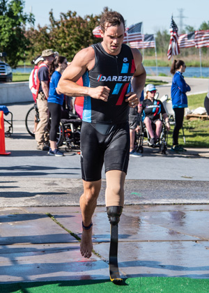 Athlete Uriah Stefan running at Leon's Triathlon.