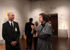 [Depicted above is curator Sean Miller discussing with his Chief of Security the impending escape of Bethany Taylor's iconography through the gallery entry and exterior door.]