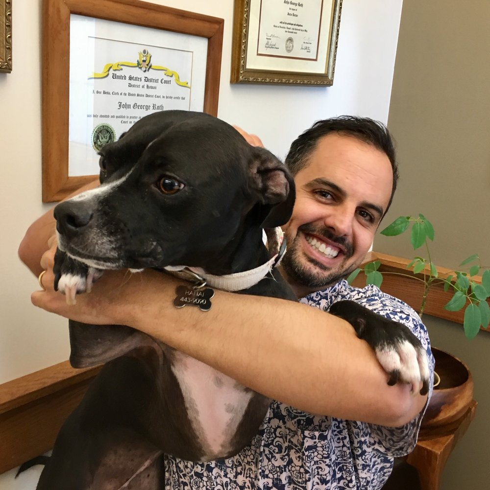 Joh and his dog, Hanai, at the Kamuela Office.