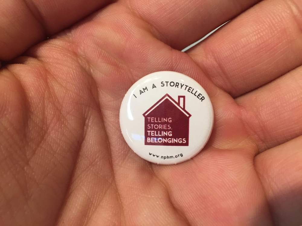 "Event attendees received commemorative pins for the event emblazoned with ""I am a Storyteller."""