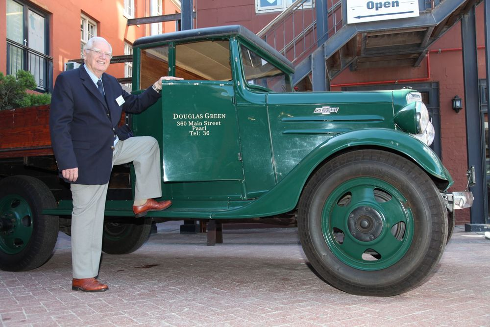 Douglas-Green-son-of-the-Founder-with-his-fathers-delivery-truck.jpg