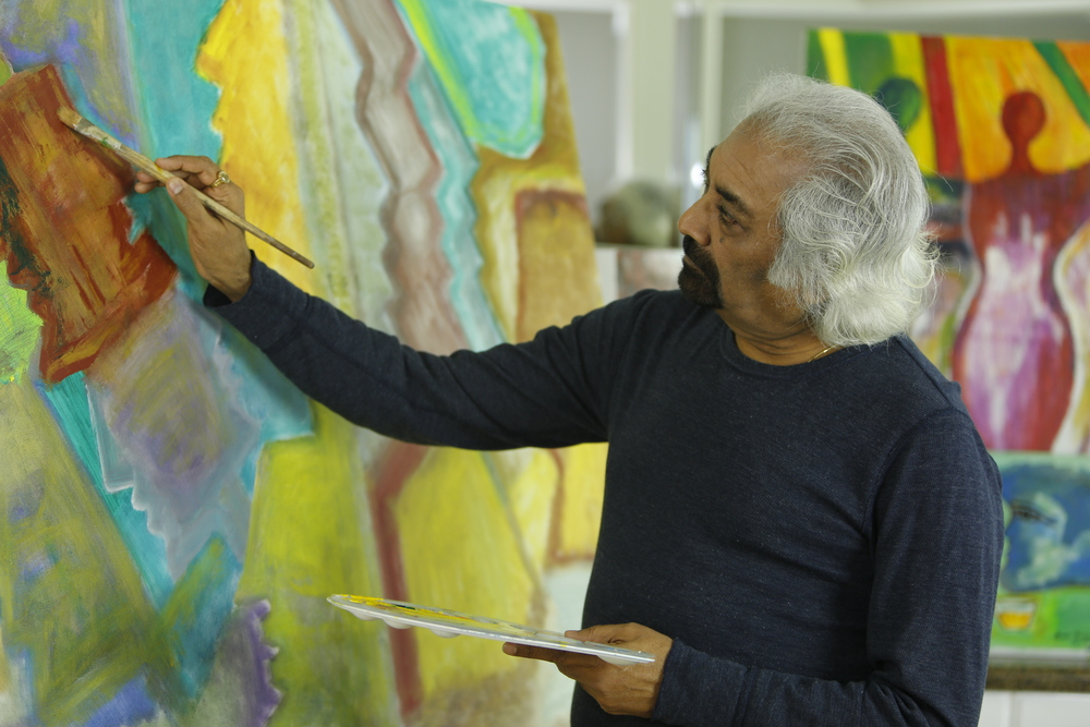 Sam painting in his home studio, Chicago, IL, USA.
