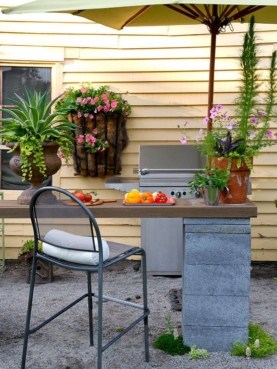 Your outdoor kitchen can be as simple or dynamic as you would like it to be.    What is most important is to make the most of the space you have.    Image as seen on bhg.com
