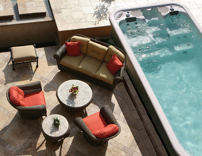 A swim spa can be easily integrated into smaller backyards as well.  Images as seen on powerpoolswimspas.com.