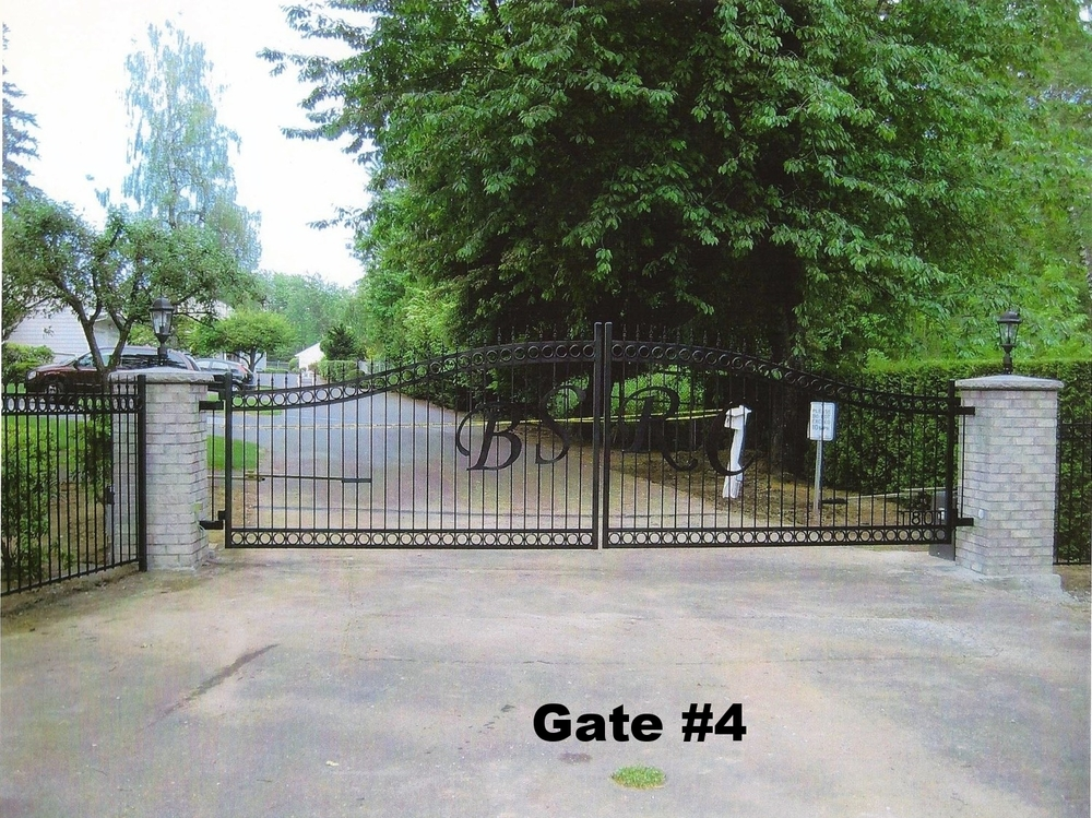 dual swing arched driveway gate with letters and automation system