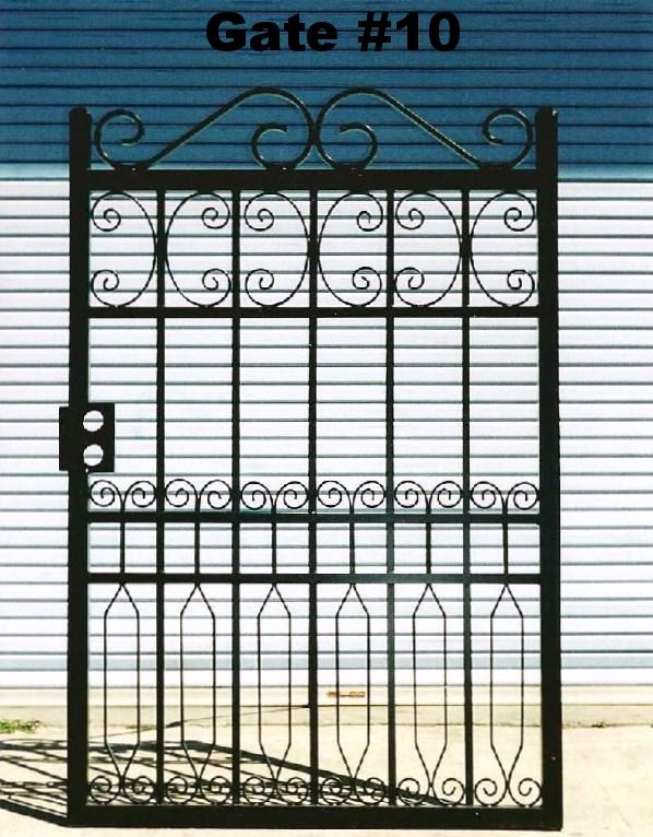 ornated ornamental wrought iron steel frame pedestrian or walk thru or man gate