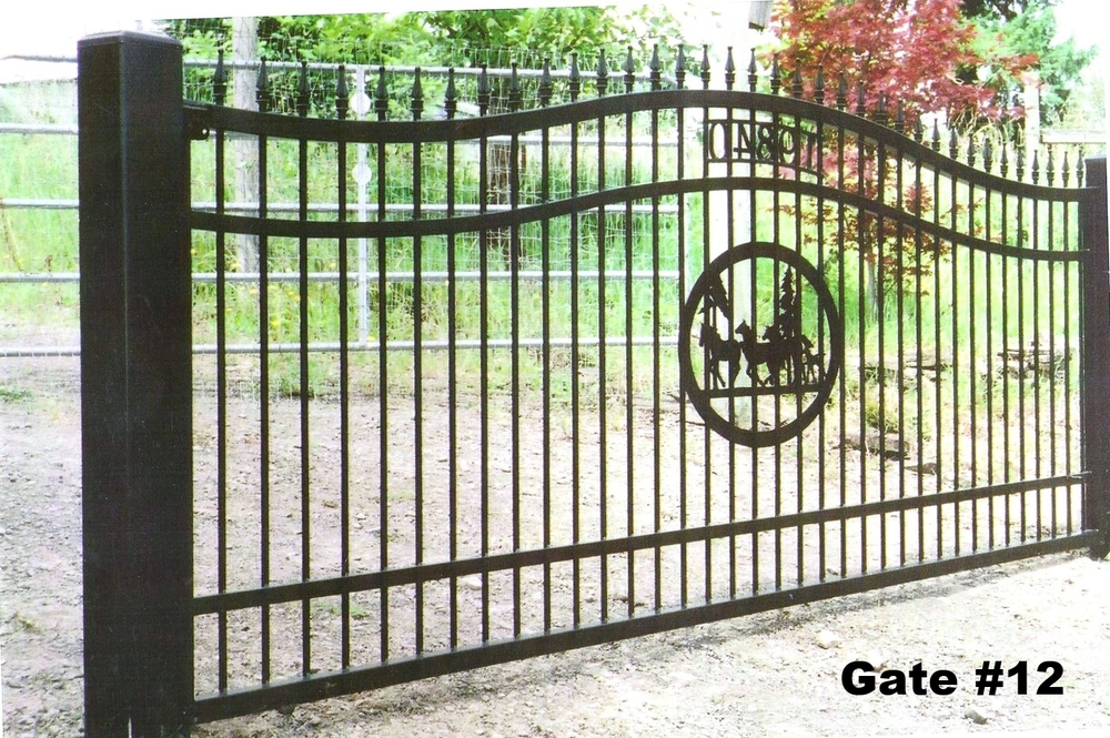 single swing ranch gate with sheet metal laser cut horses and trees