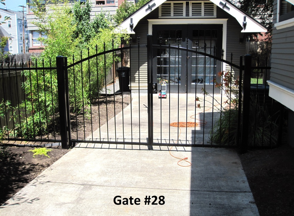 small dual swing driveway gate with door lever and key lock for downtown house security