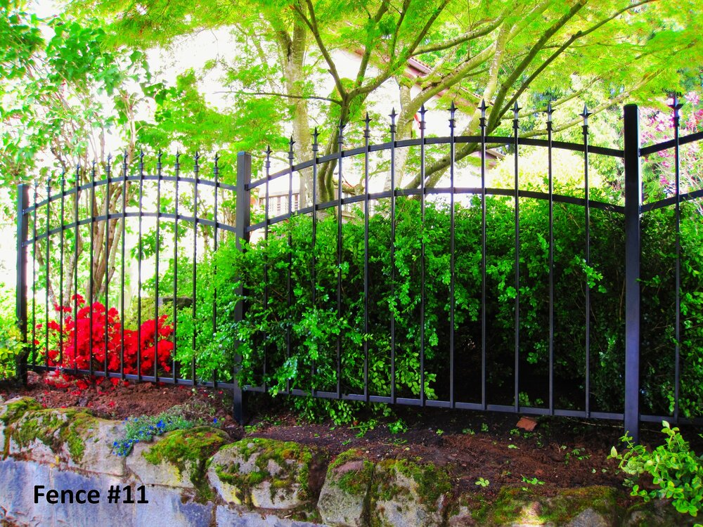 double arched fence with spears