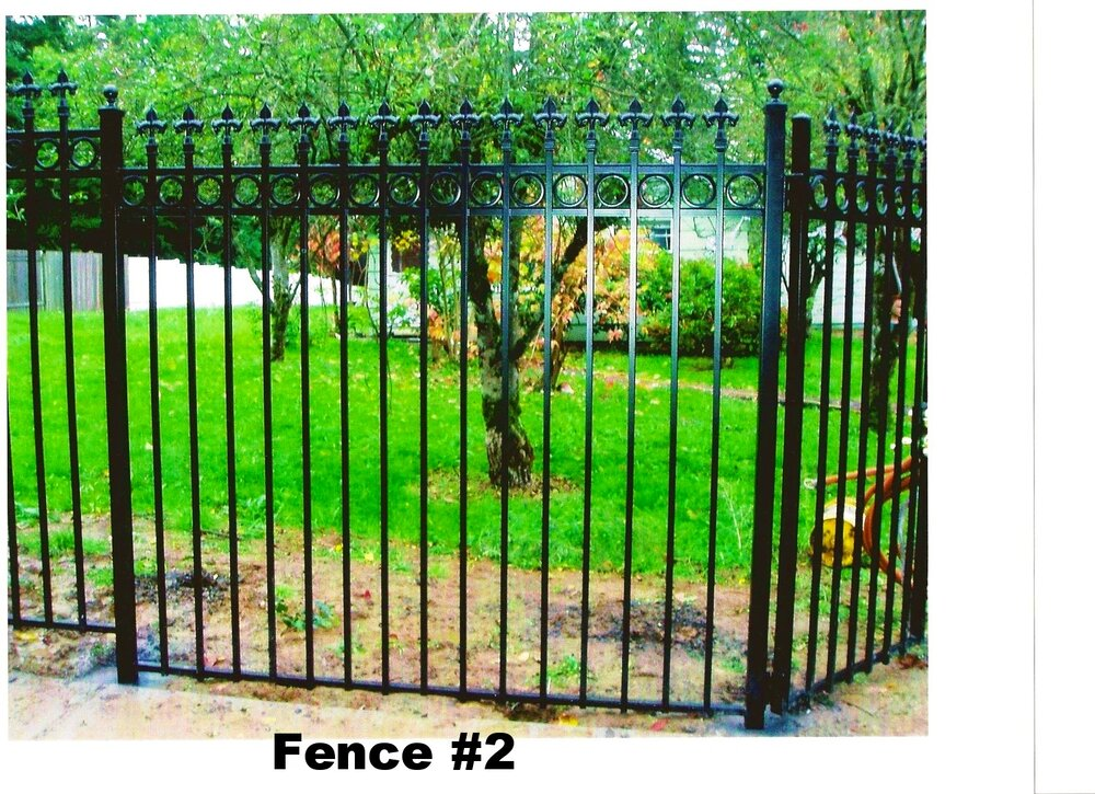 tall fence with spears on top and rings