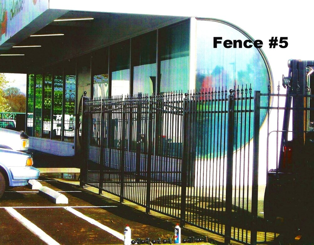 tall steel fence for car dealer