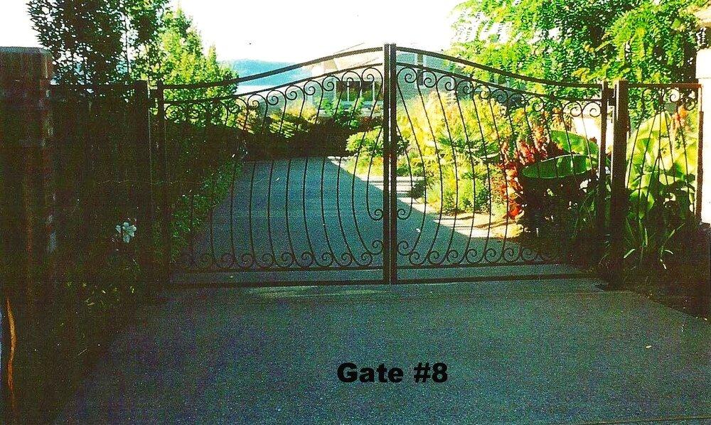 double swing slight arch custom picket driveway gate