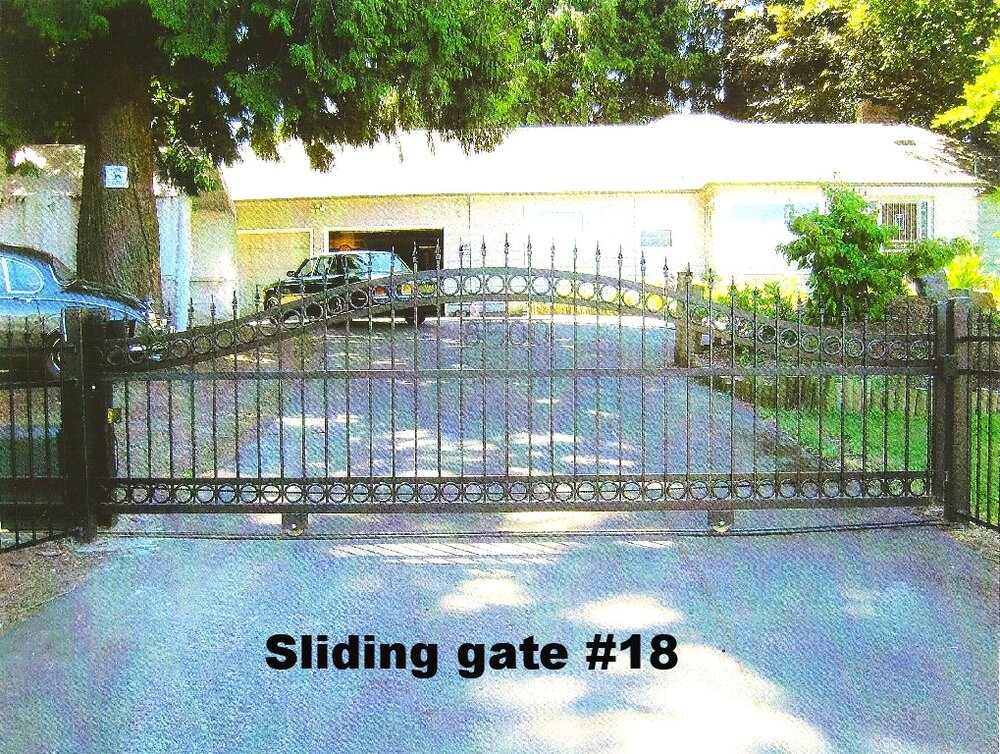 residential sliding driveway gate with arches, spears and steel rings
