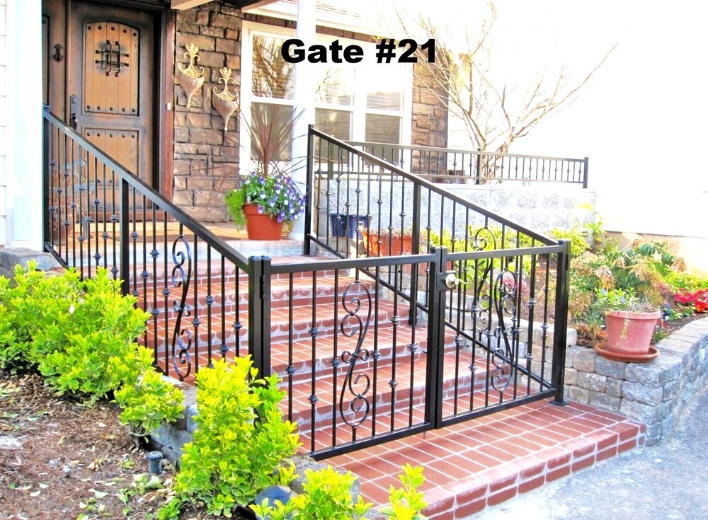 railing with forged steel scrolls center of each panel complemented by knuckles on the pickets