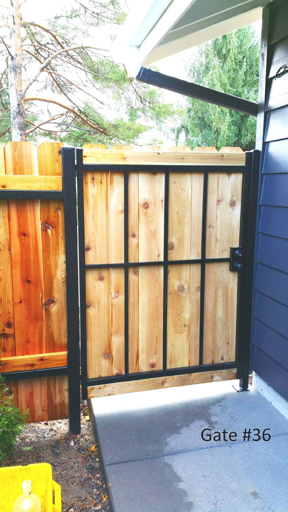 steel pedestrian gate covered with wood boards