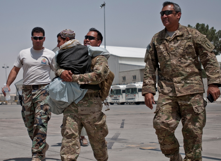 Rhamatullah, Sgt. 1st Class Rivera, Maj. Martinez, and interpreter boarding the aircraft.