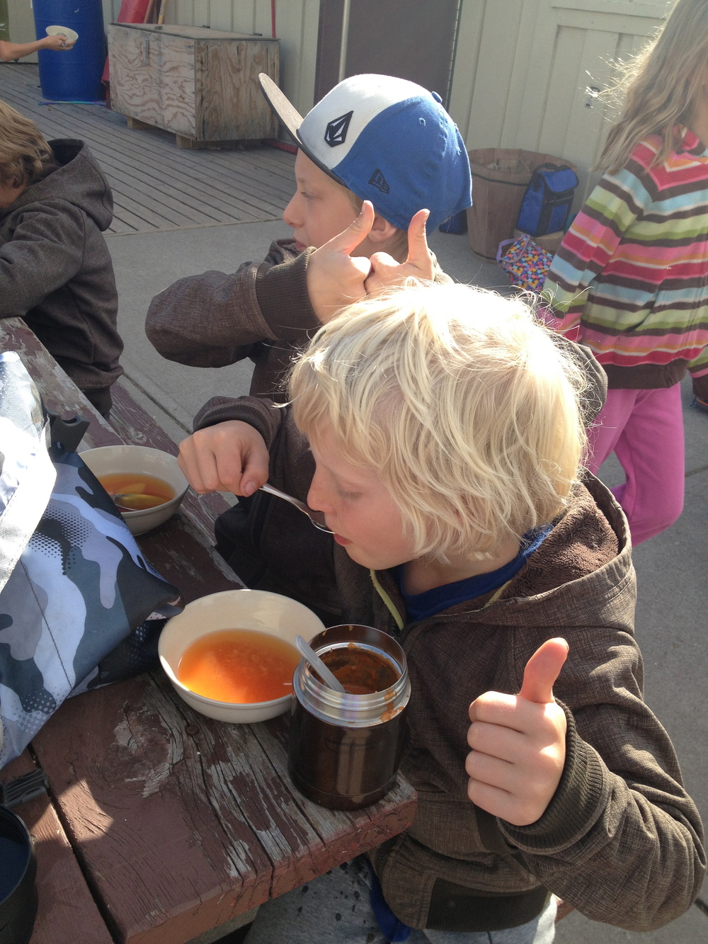 Pride. Teamwork. Confidence. Enjoyment. Through Chris from the Farm Box and Graeme the grade 3-4 teacher at Alpenglow School the class harvested the vegetables from the school's roof top garden and made soup. As you can see these boys don't have time for small talk and a photo - they are focussed on enjoying the thumbs-up soup they made with their class. These experiences promote wellness on so many levels: connection to the earth, whole good fresher than fresh food, connection with each other. Especially at this development stage in their life this is such a beautiful curriculum gift to offer the students as the step more into themselves as individuals in community.