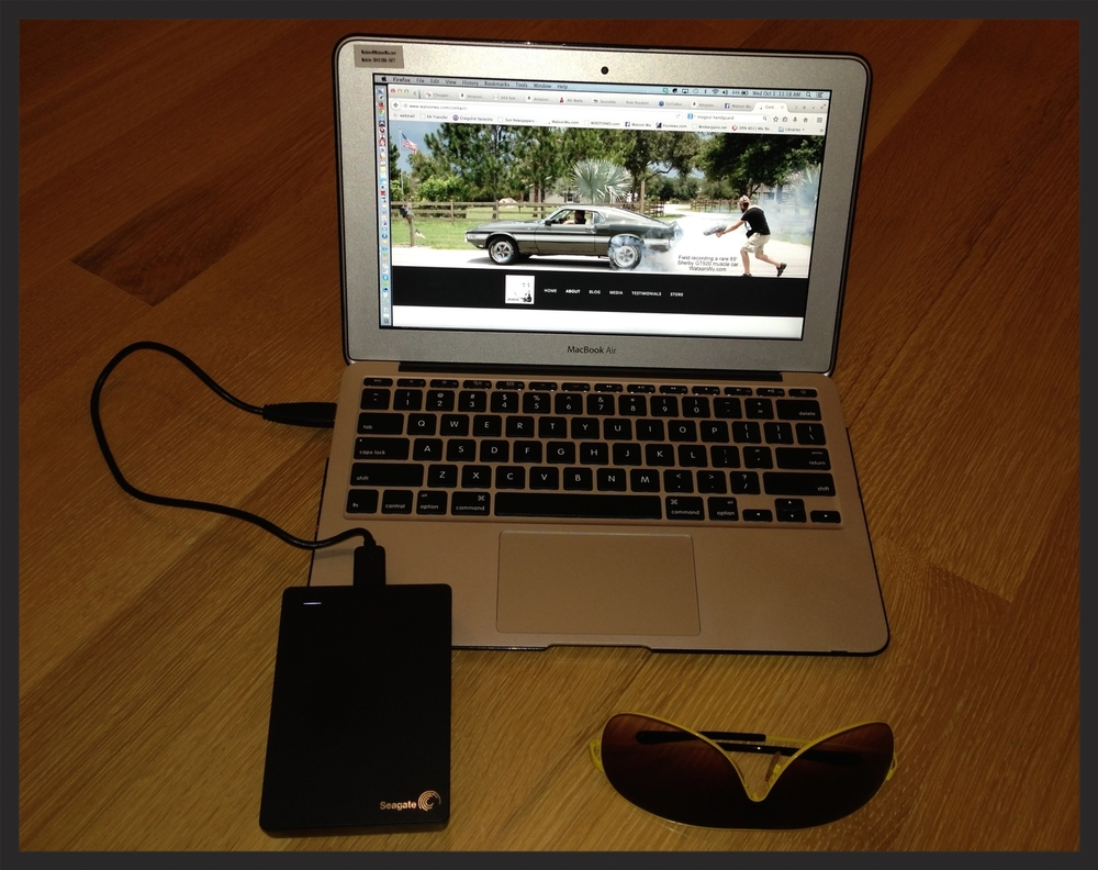 "Watson Wu's Seagate 4TB external hard drive, 11"" Macbook Air, and Sunglasses as a size reference."