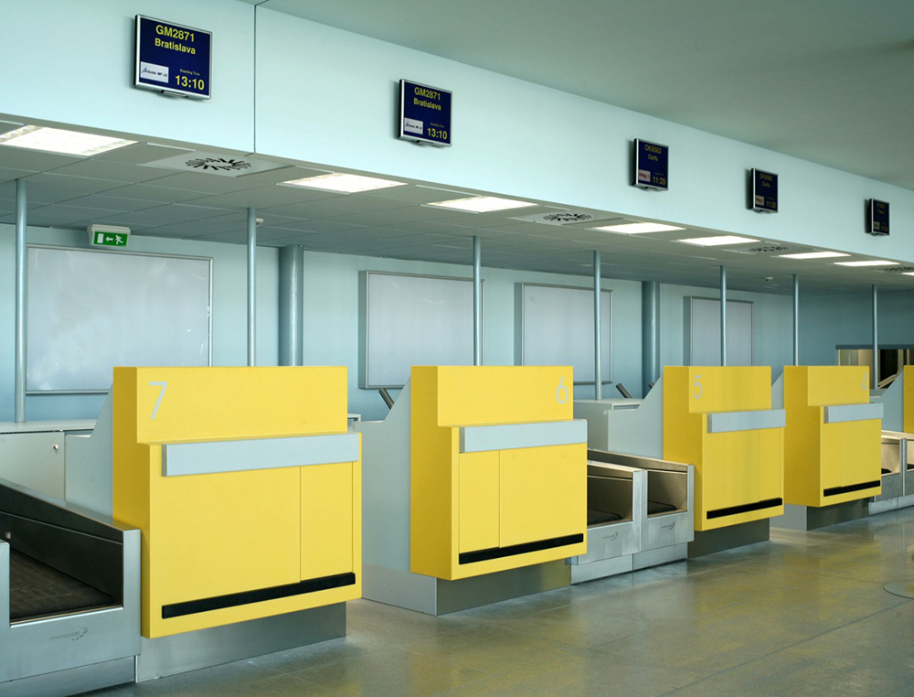 hi-macs-prague-yellow-check-in-desks-airport.jpg