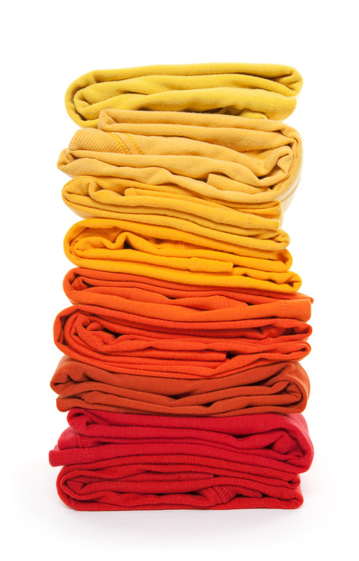 These shirts are sorted by color and then categorized again by being arranged from lightest color to darkest. See how easy it is to find each shirt?