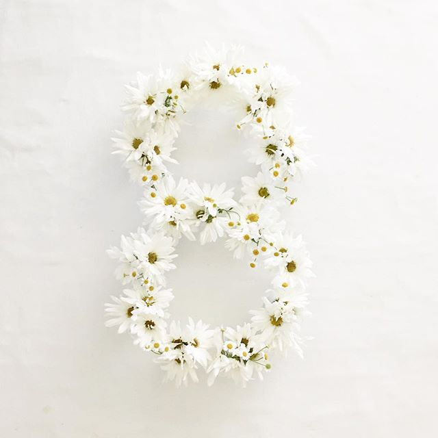 "Daisies on daisies for Elle's ""8"". Such a happy, sunny flower, just like our girl! #ellesfirst12"