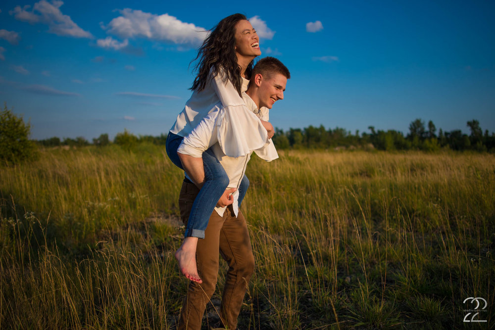 The open, grassy fields of the quarry are perfect for that romantic, boho feel to an engagement session. Bare feet, comfy jeans, and a flowing top look perfect in the sun-drenched light that Hannah + Jake had on the day of their engagement session, and Jake looked dapper but still perfectly in tune with Hannah in well fitted pants and a white button down shirt. Keeping it classy and casual, these two rocked their engagement photos in a beautiful setting, right in Dayton.