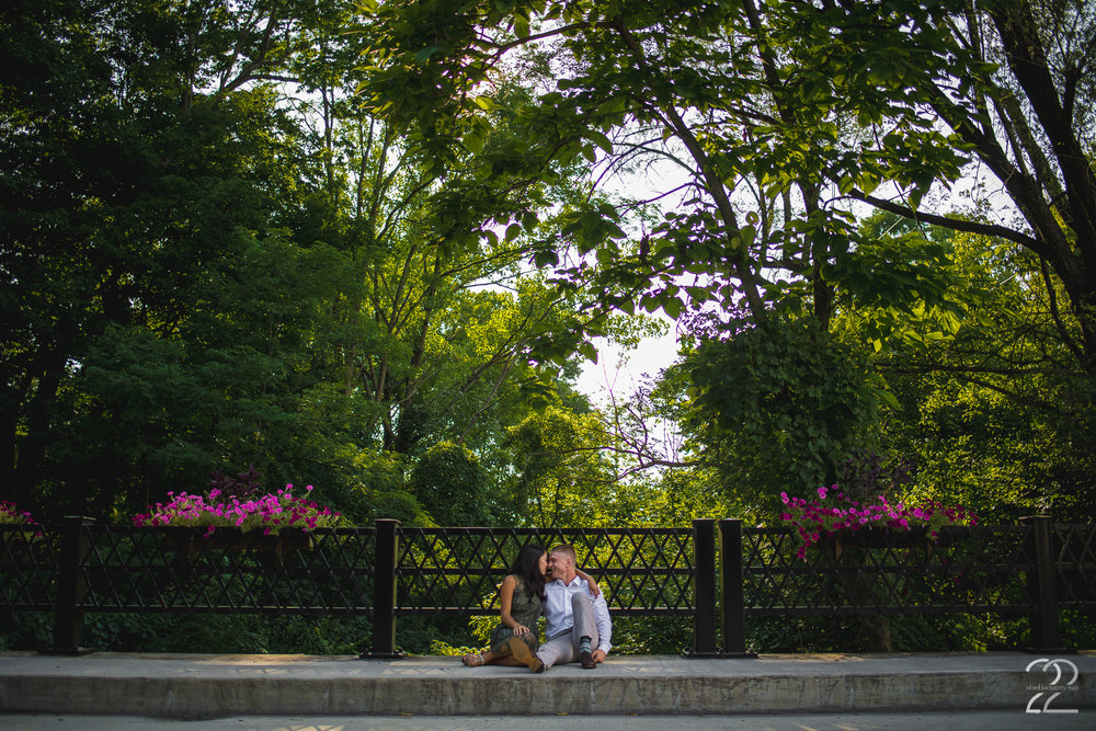 Finding beautifully manicured areas of a downtown with a small town charm, it's always nice to find spots that are new, or photograph spots in a new way. Here Jake and Leiah snuggle up on a walkway over a small river and enjoy a moment in the sun. I encourage my couples to snuggle up and enjoy one another throughout their engagement sessions, because many time those intimate moments are the best photos!