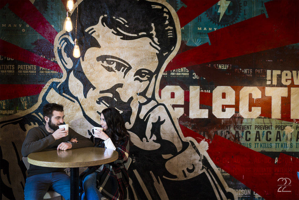 Another image from Proto BuildBar, this huge mural wall dedicated to Nicola Tesla is amazing! The high top tables and the hanging Edison bulbs are a great touch for a location dedicated to energy and the inventors of our times, and their coffee is top notch. It's the perfect place to get something unique for your engagement photos in Dayton!