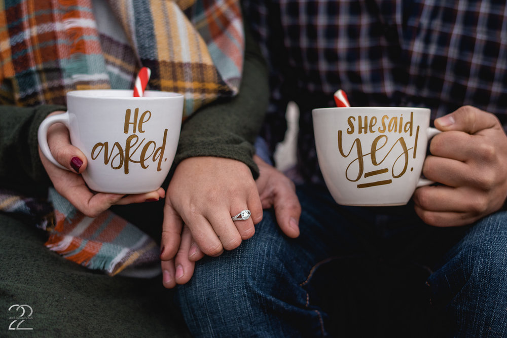 Using Ivory House Creative, we had these adorable, custom made mugs to commemorate Allen and Jenna getting engaged! Having a surprise proposal gave the perfect excuse for some great celebratory pieces during their engagement session, and these custom mugs were perfect for the occasion.