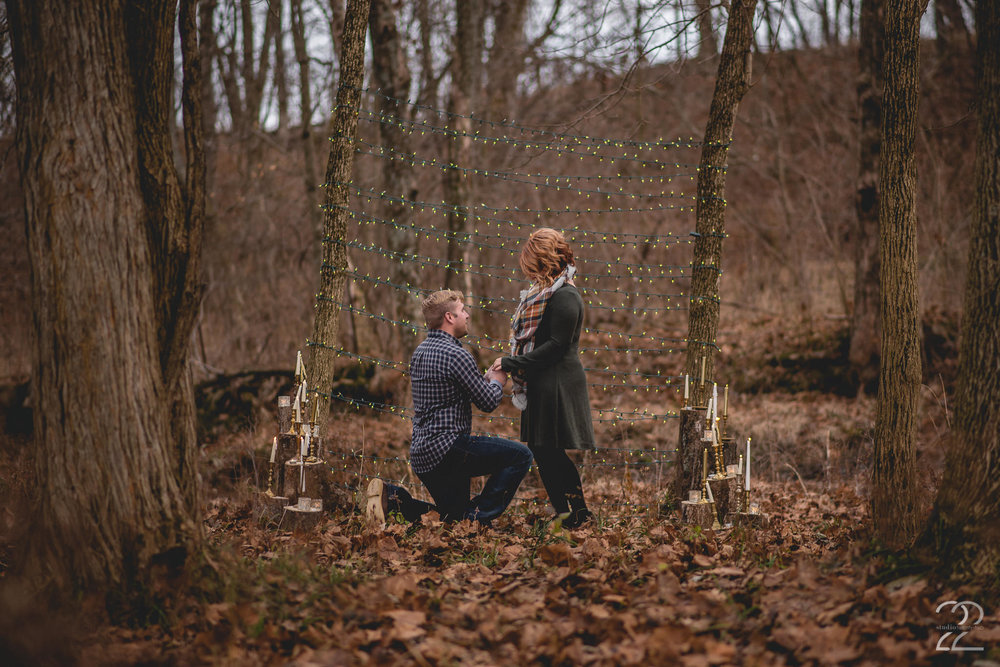 Wrapping trees with twinkling lights and building a beautiful area lined with candles, Allen came up with the perfect way to propose to Jenna on a cool winter day. Lost & Found provided beautiful candle settings and lights to set the scene for this fantastic surprise proposal!