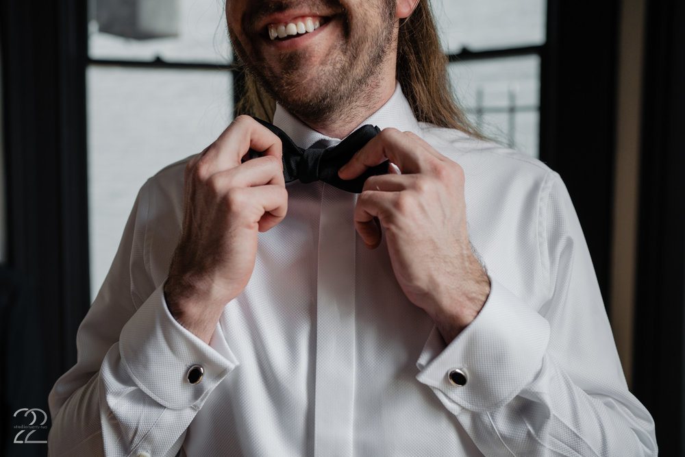 Cincinnati Beerfest mastermind Matt King made sure he would be the most dapper groom in all of Cincinnati on his wedding day with his custom wedding tuxedo from Romualdo Tuxedos in Cincinnati, Ohio! Opting for a stunning French cuffed dress shirt and a classic bowtie, Matt stepped his game up with a custom green suit from Romualdo that was made with all the trimmings that one would expect from the Cincinnati Beerfest King! His wedding style was timeless, with just the right splash of fun. Perfect way to style your Cincinnati wedding!