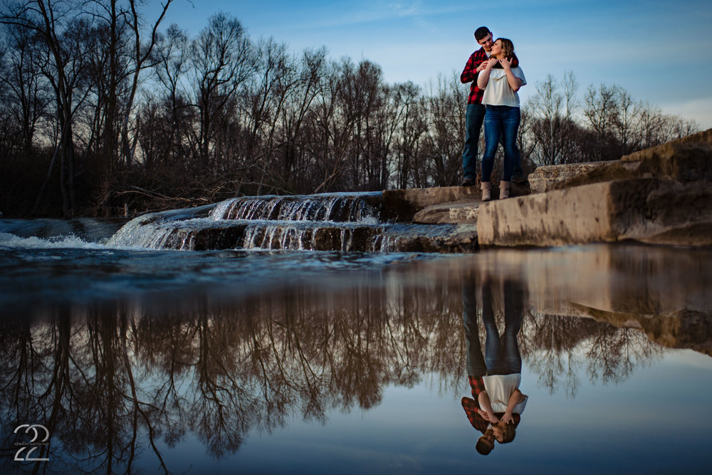 Reflection shots are something that if done well can add a unique and beautiful image to your engagement photos. Megan of Studio 22 Photography  loves to test our different tricks and techniques like this in order to give you a wide variety of images of you and your partner while she is out adventuring with you both.