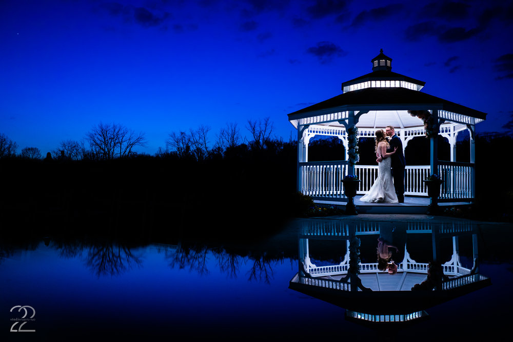 "Nighttime wedding photos are some of my favorite wedding portraits to create, and it was a blast to get to create with Nick and Erica after the sun went down! One of my favorite times to create is during ""blue hour,"" which is right after the sun sets, but the sky retains that beautiful blue hue for just a bit longer. It's the perfect time to go outside for some night time wedding portraits, and we took full advantage of Aston Oaks' beautiful scenery, even at nightfall!"