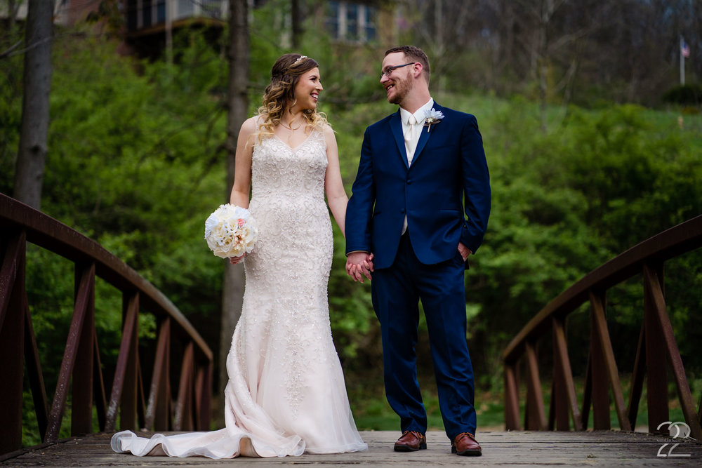 Nick and Erica chose to get married at Aston Oaks Golf Club in Cincinnati, Ohio on a warm spring day. Doing their first look on a beautiful bridge alongside one of Aston Oaks' greens, the golf course was a beautiful backdrop for their first look and wedding portraits.