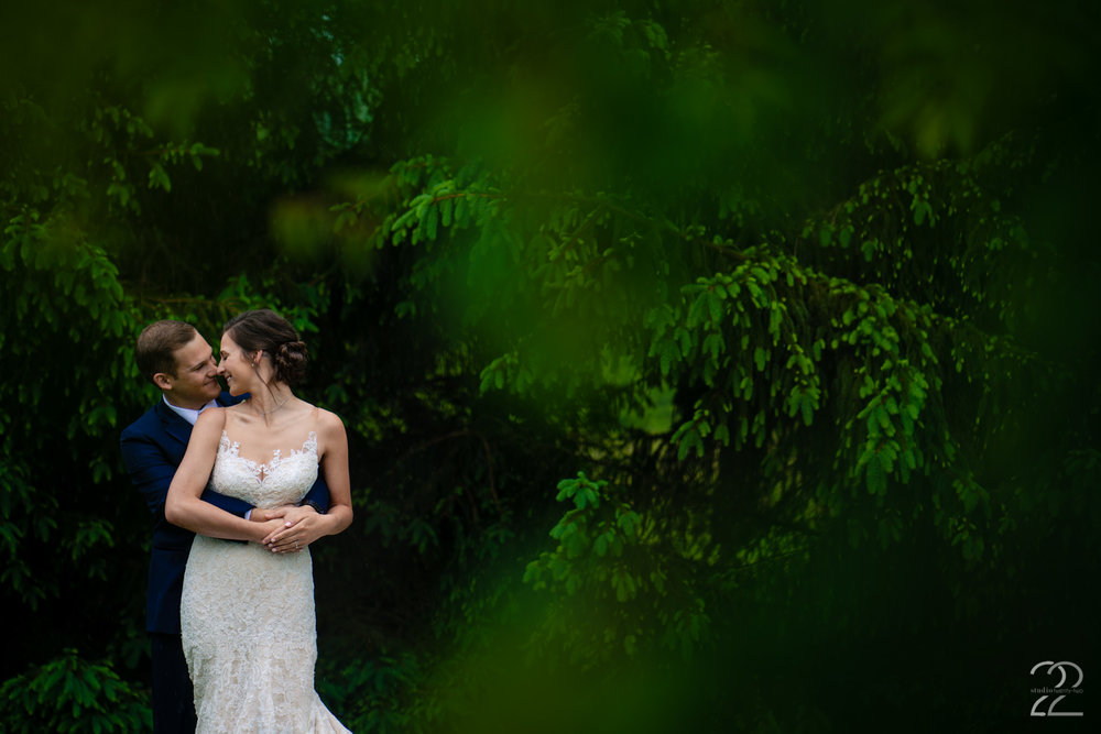 The gorgeous greens that surrounded Morgan and Caleb at The French House in Cincinnati, Ohio allowed for spectacular places for formal wedding portraits.