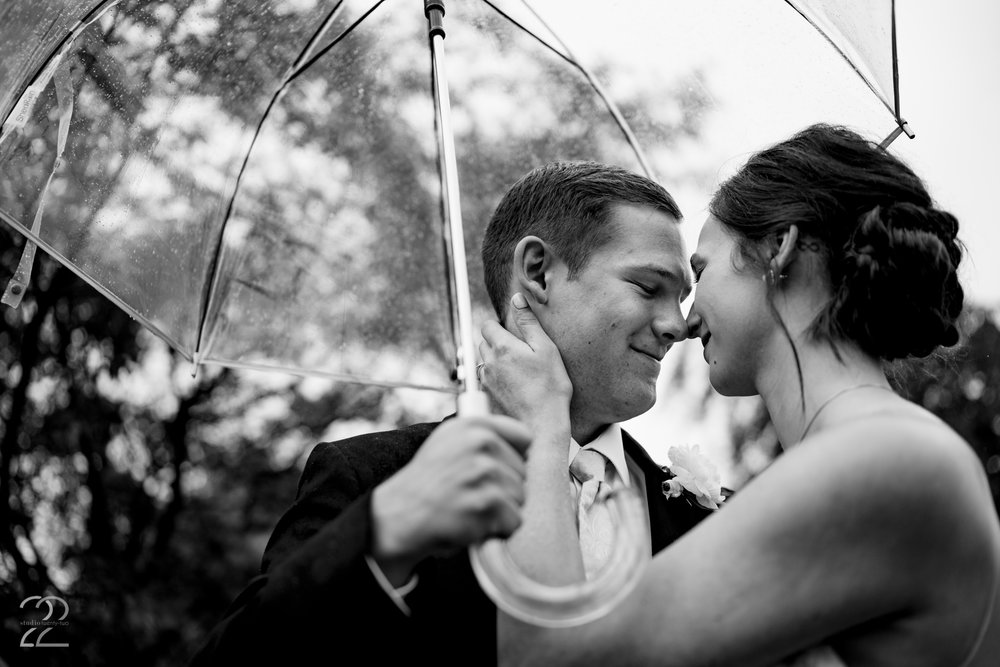 Don't let weather get you down on your wedding day. It is the perfect chance for you to snuggle in close and provides intimate and loving photos.