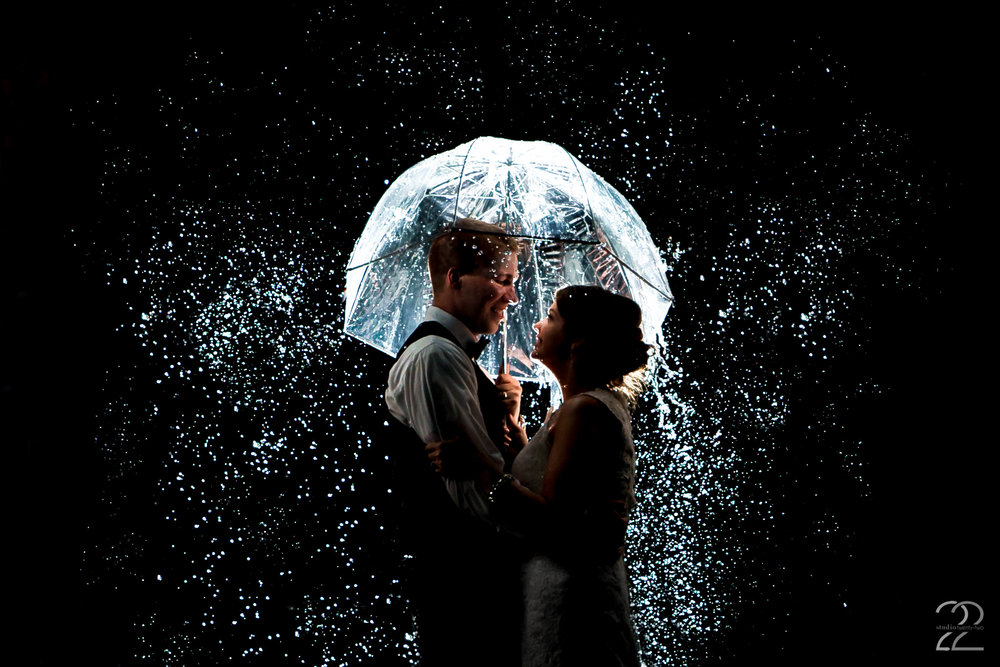 It is said that rain brings good luck on your wedding day. As a photographer it is always way more fun to have challenges or unexpected things (like a light rain) to create in! Andrea and Patrick were so trusting of Megan to create a beautiful rainy night bride and groom portrait for them in Boston.