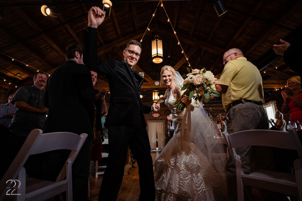 Adding your own personality to your wedding will always create fun wedding photographs. Dillon and Corrie danced out of their wedding ceremony at Top of the Market. The guests loved it.