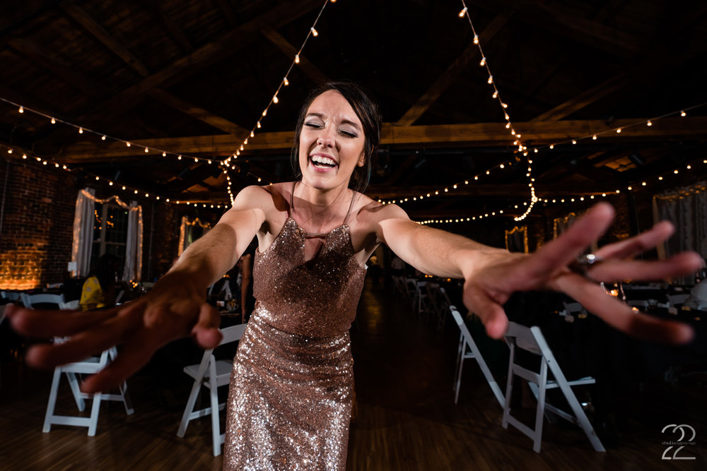 Megan at Studio 22 Photography loves to get in close to capture the action, but don't worry we guarantee you will forget she is there and your guests will love watching her lay on the floor or climb on chairs.