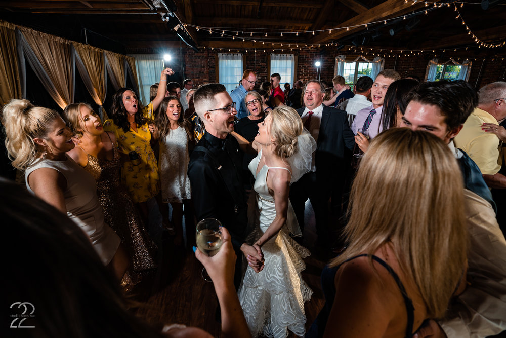 Top of the Market in Dayton, Ohio  has multiple spaces for your wedding day that are equally unique and gorgeous. The Loft was the perfect spot for Dillon and Corrie's intimate reception.