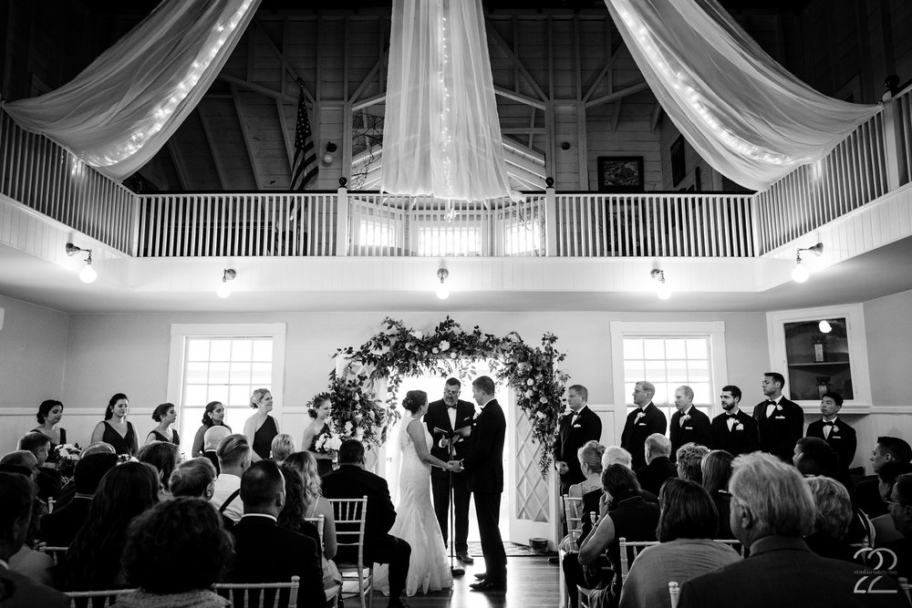 When weather derails outdoor plans it can be stressful. Thankfully the wedding planner and York Golf & Tennis Club had things under control and created a beautiful indoor ceremony for Andrea and Patrick.