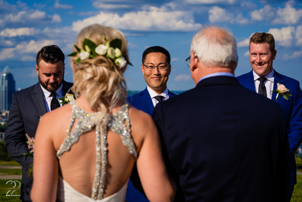 The look in a groom's eyes when he sees his bride walk down the aisle is something that she never wants to forget. Megan at Studio 22 Photography makes sure to capture all the key moments of your wedding ceremony for you, and the ones you didn't expect as well. This beautiful moment at Drees Pavilion shows how important these shots truly are.