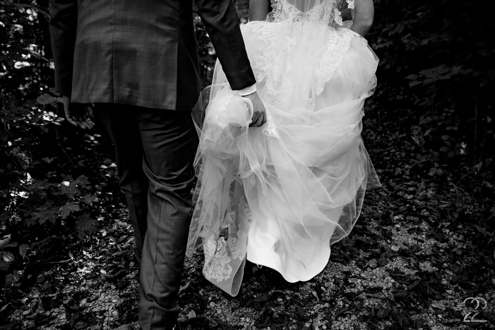 Rocky was such a gentleman helping keep Cassie's wedding dress from collecting autumn leaves or rocks on our adventures. These in between little moments that the couple may not remember otherwise are some of Studio 22 Photography's favorites to capture.