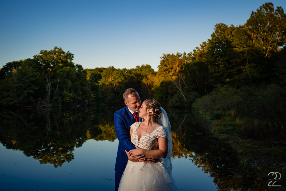 Golden autumn sun, the stunning natural setting at Krippendorf Lodge, and two people madly in love create dream wedding portraits. Getting to capture these two on their magical day was an honor.
