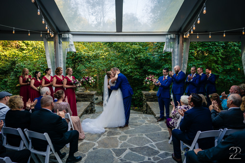 Every wedding photographer ensures they get a photo of the first kiss. Having a stunning venue like Krippendorf Lodge in Cincinnati as your background (as well as a great bridal party) brings a typical photo up ten notches.