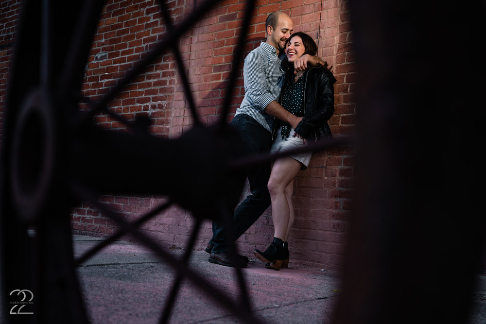 When choosing locations for engagement photos it is often better if we are allowed to just explore. Sometimes the unexpected spots turn into the coolest photos, like this simple brick wall in downtown Dayton, Ohio.
