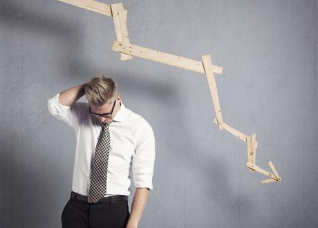 stressed businessman graph downward trend