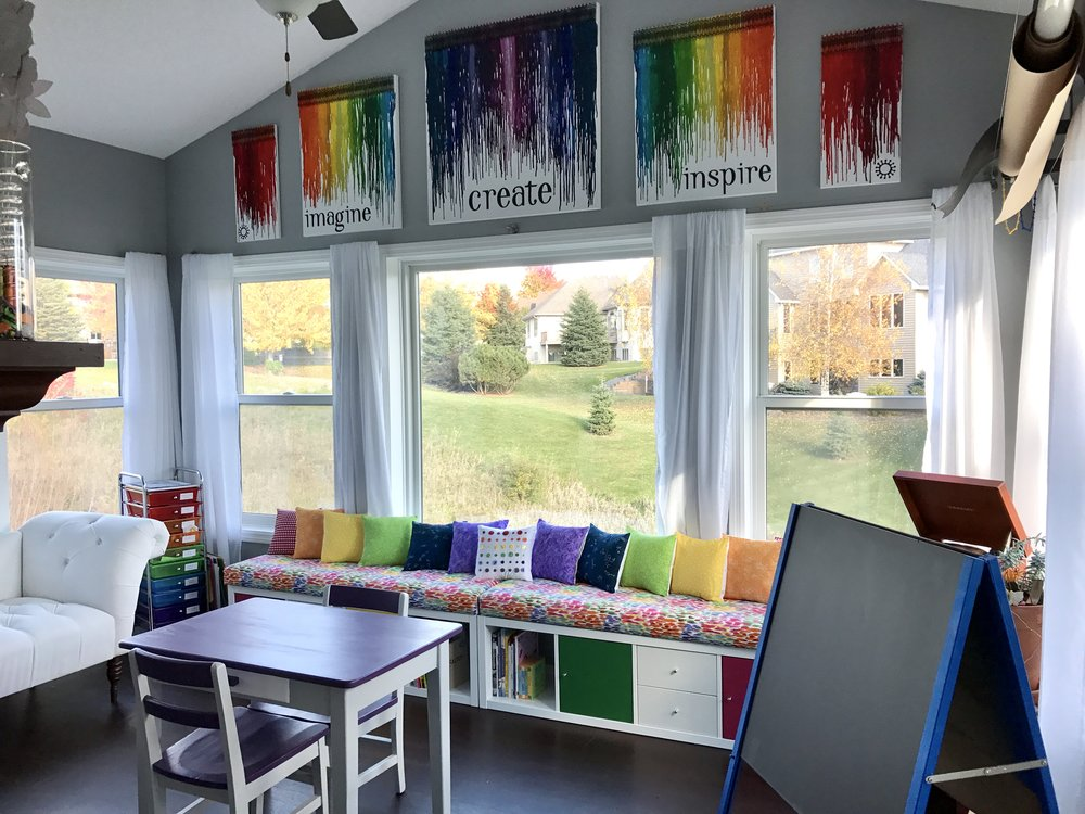 "Here is the main over view when you walk in. The canvases on the wall are made from melted crayon... 324 crayons on 108"" of canvas. The kids loved melting these with me."