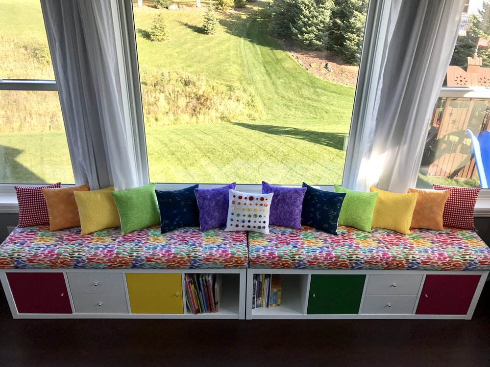 The book cases are from Ikea, but the bench seat and all of the pillows were hand sewn by me. Eeek! I actually sewed my very first thing a week ago, and these were numbers 2-16 on my list of sewn items!