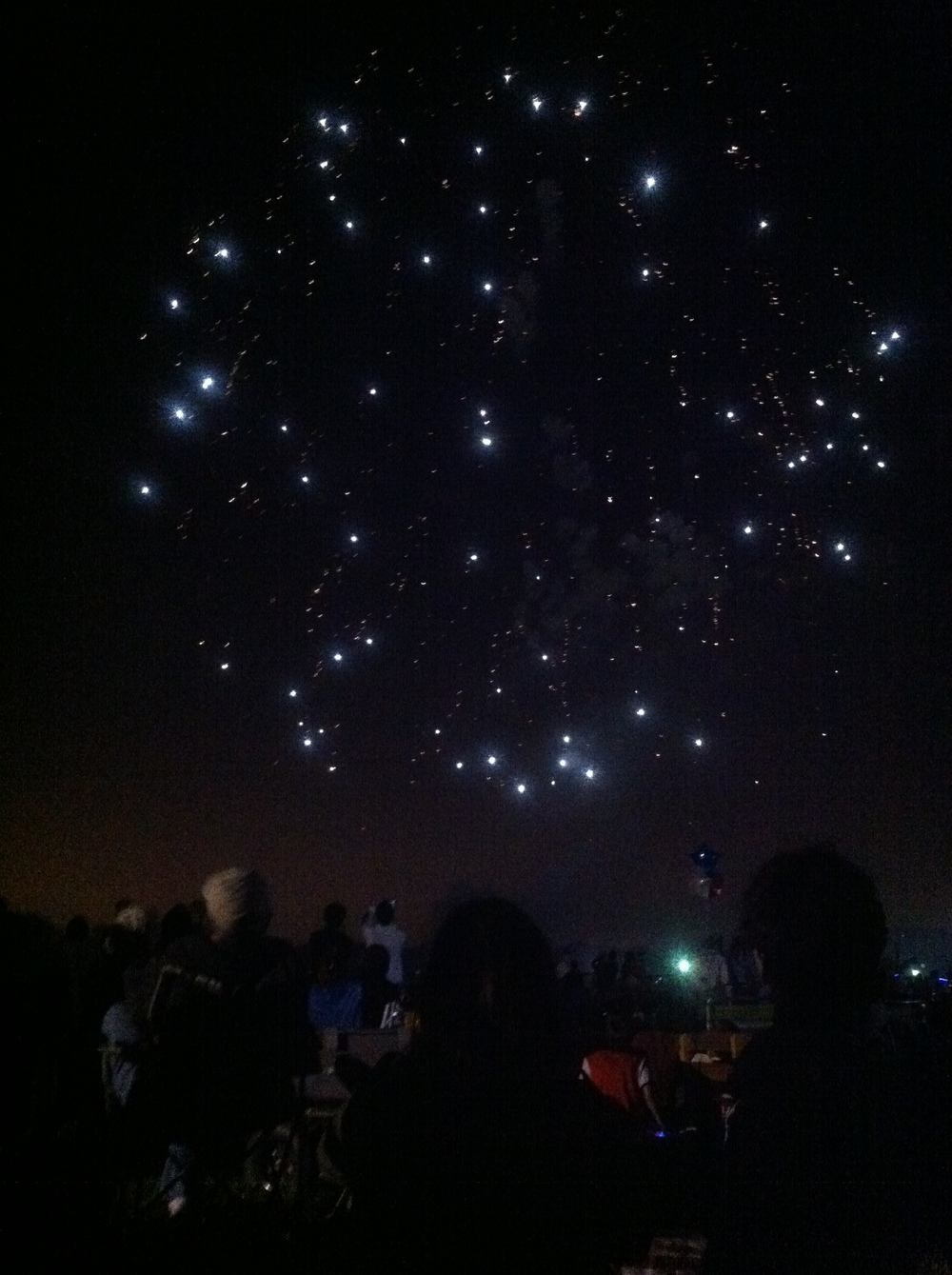 Taken with the iPhone. The sky looks so starry, even though they're actually fireworks!